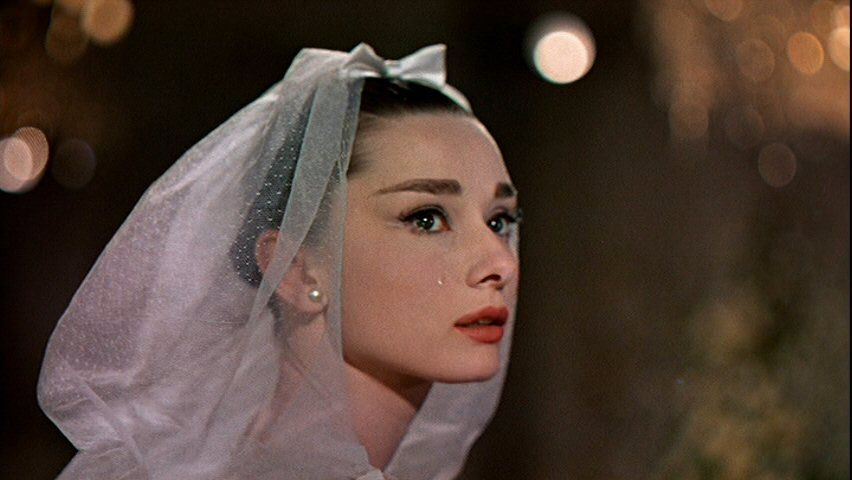 funny face audrey hepburn wedding veil portrait crying tears dress 50s